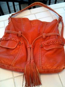 brown leather purse with tassels